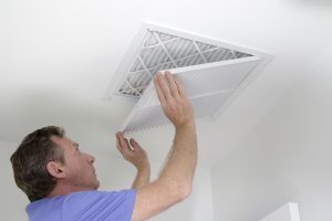 Man checking vents